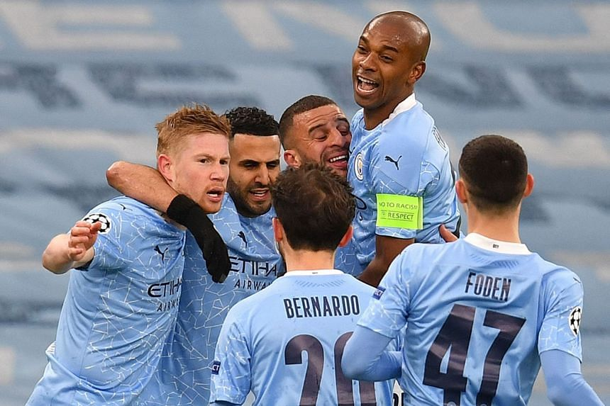 City's Riyad Mahrez (second from left) is mobbed by teammates after scoring the opening goal.