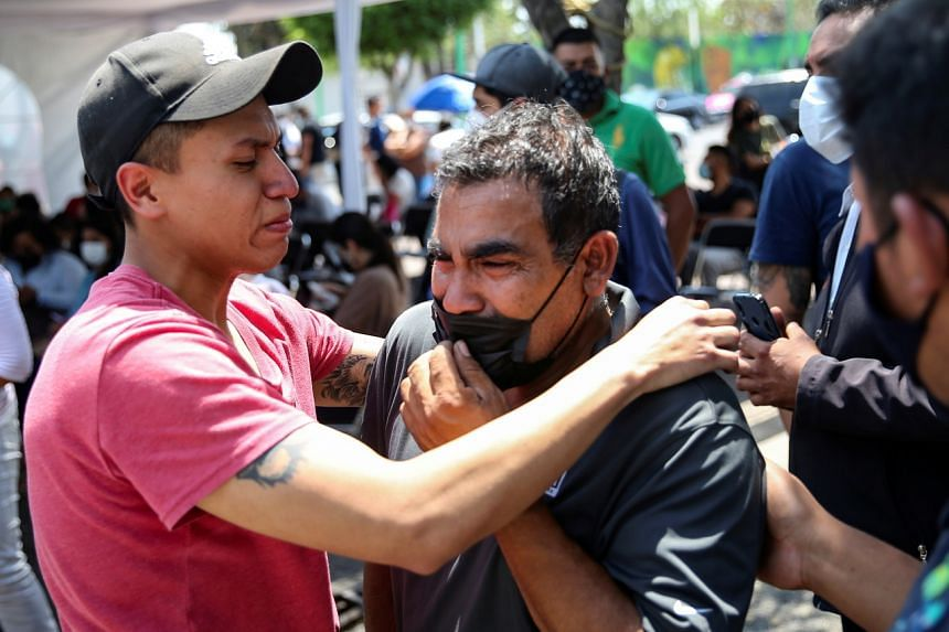 Relatives of the victims outside the Prosecutor's Office in Iztapalapa neighbourhood, after the overpass of the metro partially collapsed in Mexico City on May 4, 2021.