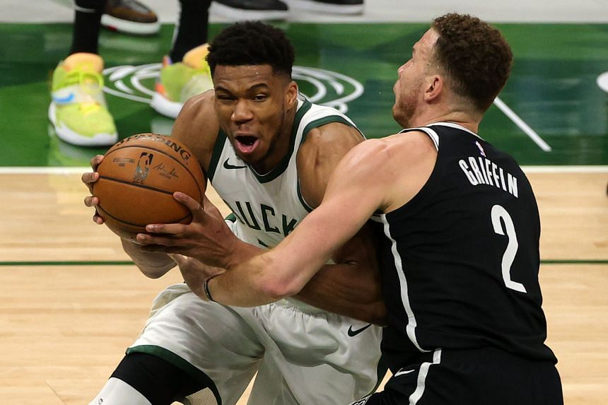 Giannis Antetokounmpo (left) is defended by Blake Griffin during the second half of a game at Fiserv Forum on May 4, 2021.