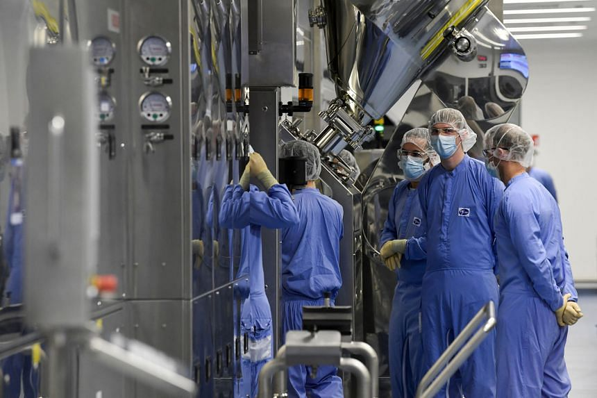 Employees at a Pfizer vaccine plant in Belgium last month. A temporary suspension of intellectual property provisions, which prevent developing nations' access to the technology needed to make their own versions of Western-made Covid-19 vaccines, wou