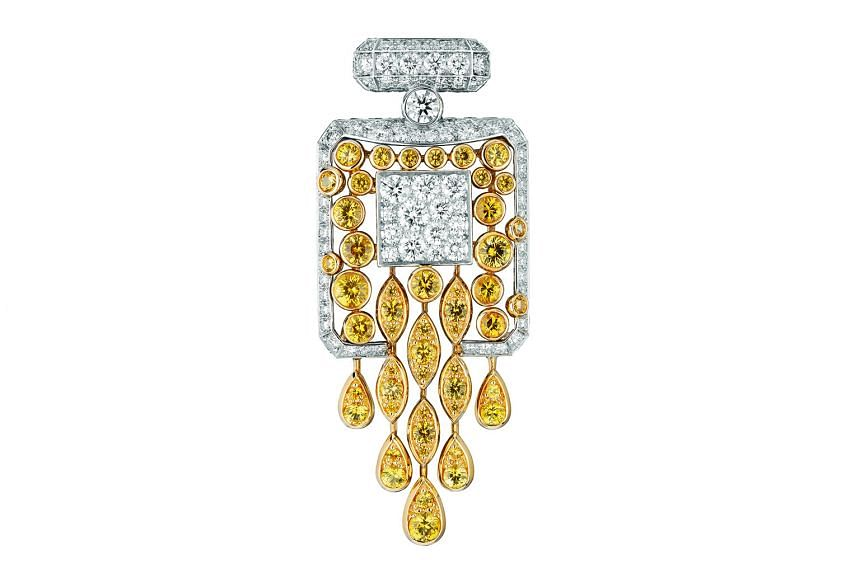 THE BOTTLE: The No. 5 Signature Bottle brooch made with white gold, diamonds and yellow sapphires for Collection No. 5.