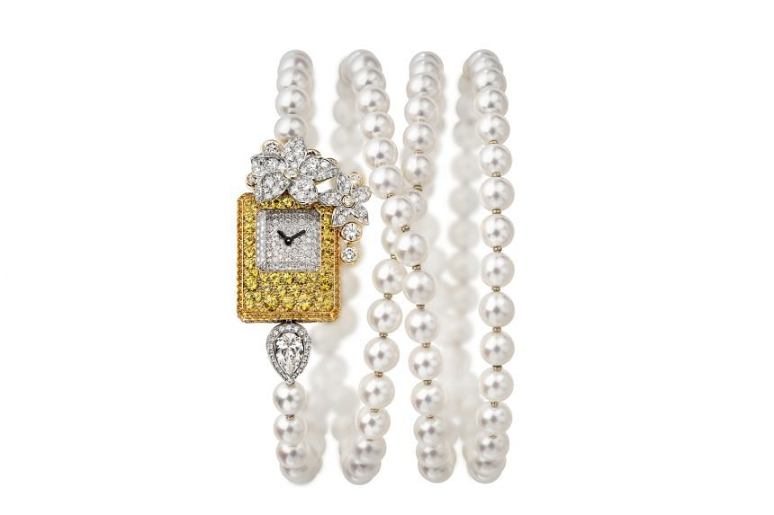 THE FLOWER: The Grasse Jasmine watch (above) can be worn as a bracelet or a sautoir.