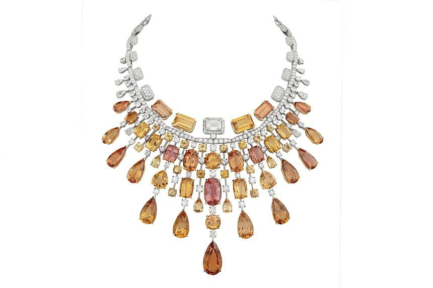 THE SILLAGE: Sporting a radiating design with cascading gems of amber and gold tones is the Golden Burst necklace, comprising 54 imperial topazes set in yellow gold and platinum.