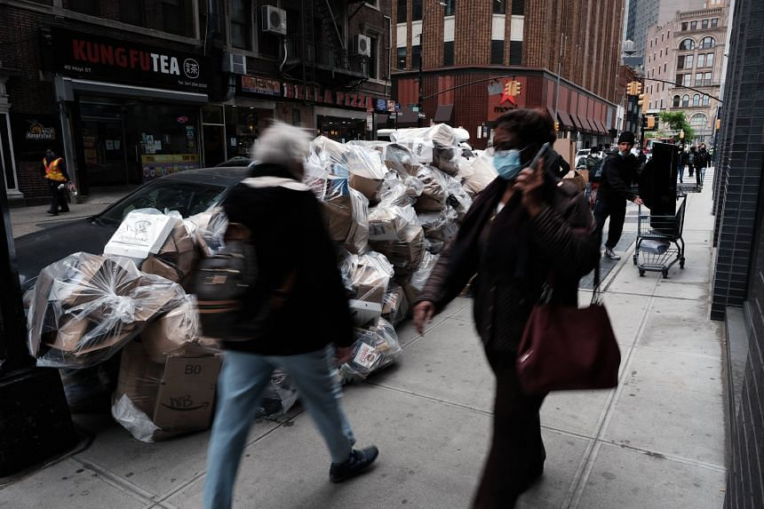 """A street in downtown Brooklyn in New York City. More than half of Americans told the Pew Research Centre last year that they believed most people in the United States look out for themselves rather than help others. As Pew noted, """"the less interperso"""
