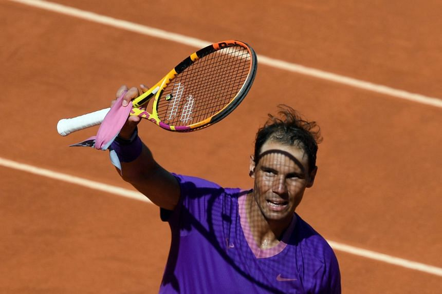 Nadal celebrates beating Spain's Carlos Alcaraz.