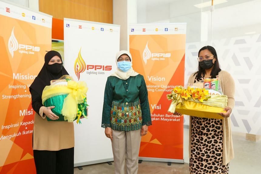 President Halimah Yacob giving out hampers to beneficiaries at the PPIS Family Services Centre in Bukit Batok on May 5, 2021.