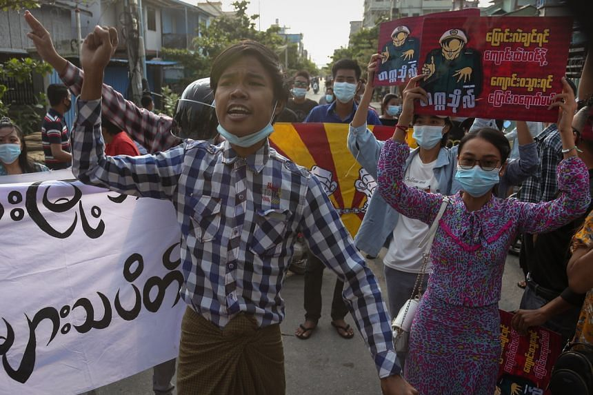 Demonstrators march during an anti-military coup protest in Mandalay, Myanmar, on May 5, 2021.