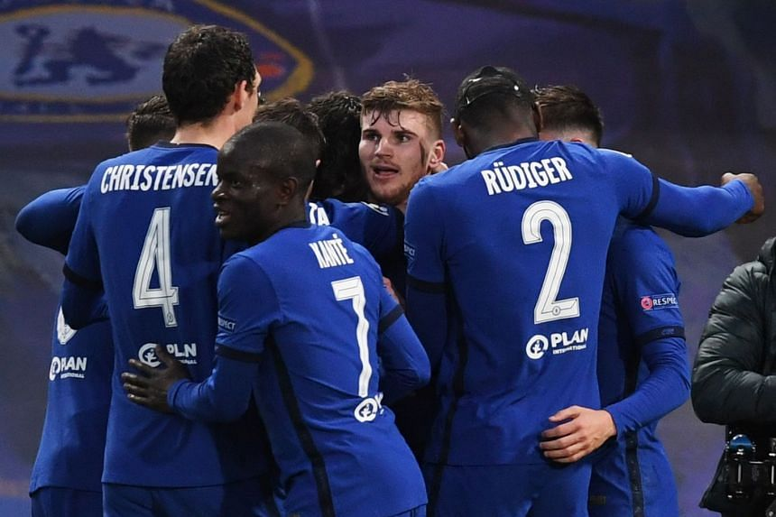 Timo Werner (facing) of Chelsea celebrates with teammates after scoring the opening goal.