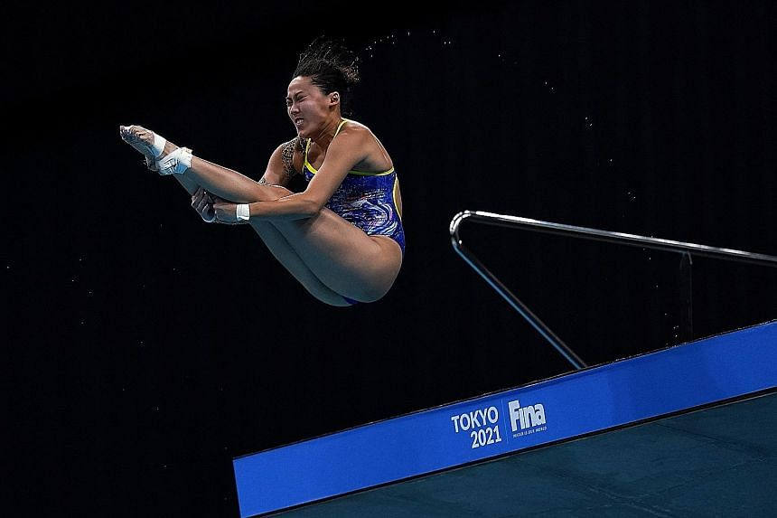 Singapore's Freida Lim on her way to finishing 15th in the field of 18 with a five-dive score of 272.35 in the women's 10m platform semi-final at the Fina Diving World Cup in Tokyo yesterday. Her result meant that she should have done enough to quali