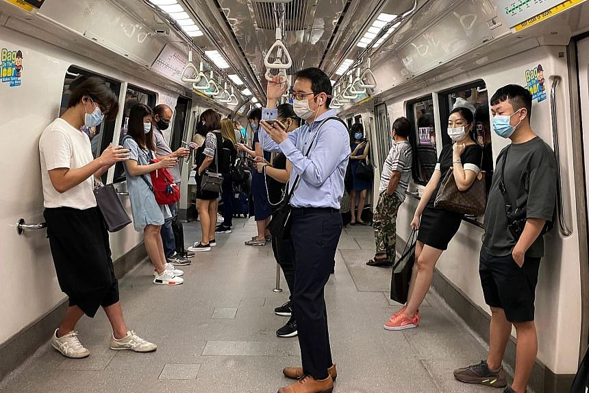 Commuters on a train travelling towards the Central Business District on Tuesday. The multi-ministry task force tackling Covid-19 has reduced the cap on employees in the workplace to 50 per cent of those able to work from home from Saturday to May 30