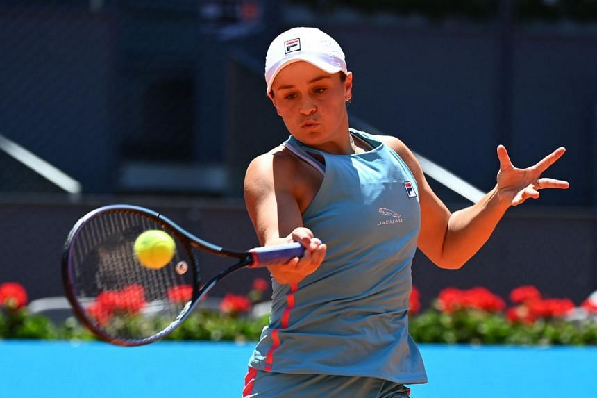 Australia's Ashleigh Barty serves to Spain's Paula Bados during the Madrid Open singles semi-final match, on May 6, 2021.