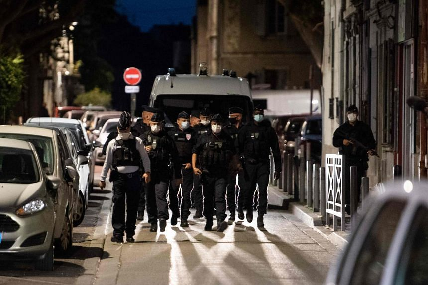Policemen securing the site where an officer was killed in Avignon, France, on May 5, 2021.
