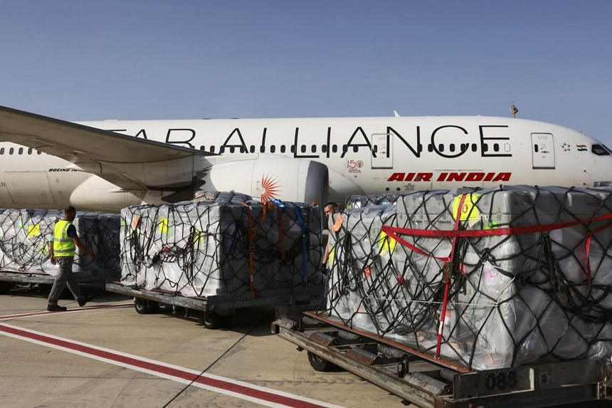 Workers loading medical aid packages onto an Air India plane in Tel Aviv, Israel, on May 4, 2021.