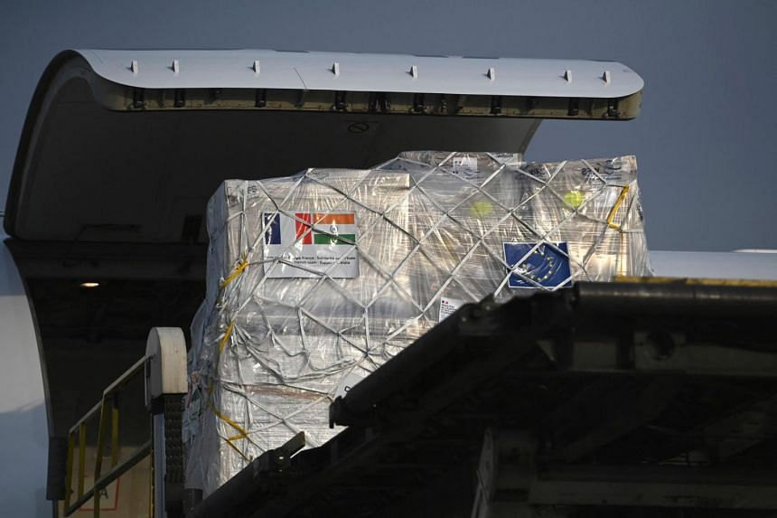 Medical supplies from France are seen being unloaded at Indira Gandhi International Airport in New Delhi on May 2, 2021.