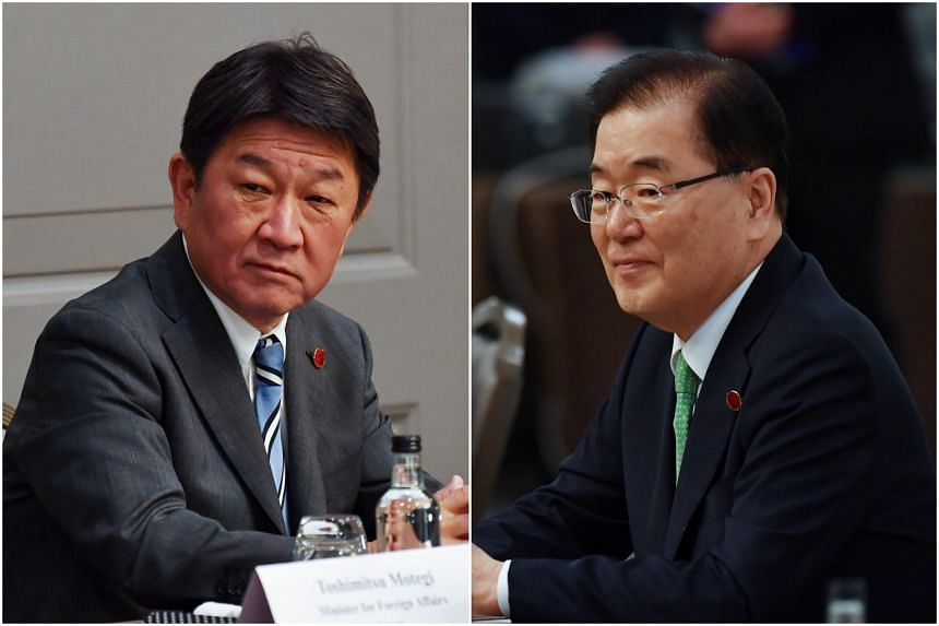 Japan's Toshimitsu Motegi (left) and South Korean's Chung Eui-yong did concur on the importance of cooperation, said statements from both governments.