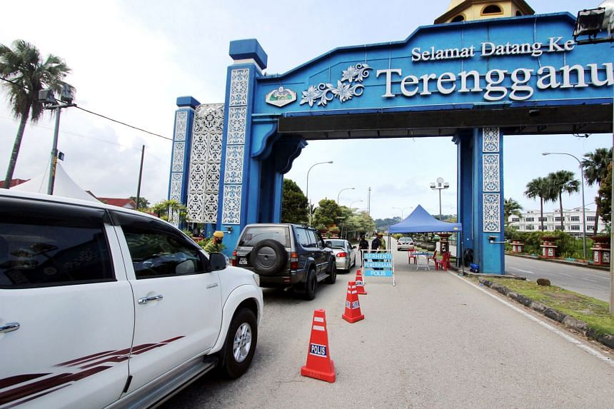 A roadblock at the Pahang-Terengganu border on April 15. The fresh MCO includes curbs such as banning dine-ins, with food prepared only for delivery and takeaways. With inter-state travel banned since January, people separated in different states hav