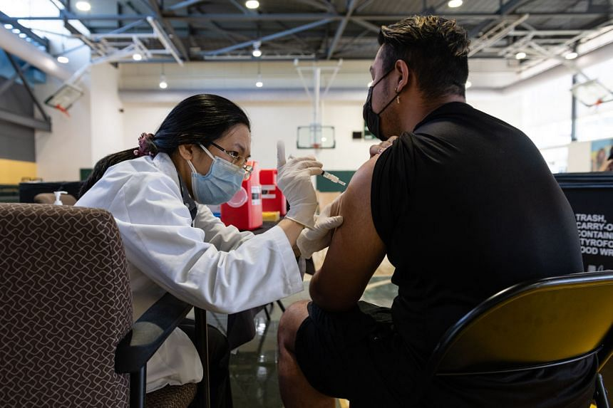 A medic administering a dose of vaccine in Washington on April 27. President Joe Biden says he wants 70 per cent of American adults to get at least one shot of the vaccine by the July 4 holiday and has made vaccinating adolescents a key part of the n