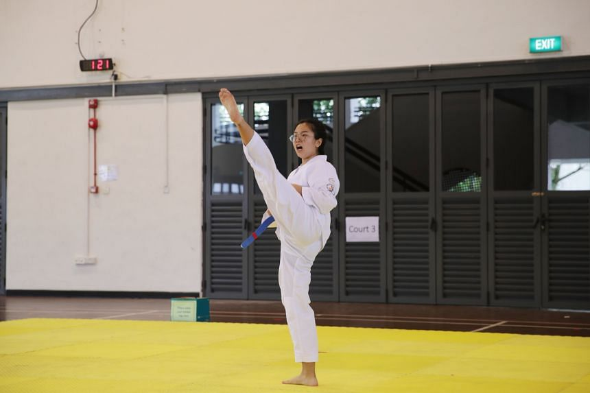 Zhang Yani from Tampines Meridian Junior College competing during the Schools National A Division taekwondo (poomsae) competition, on May 5, 2021.