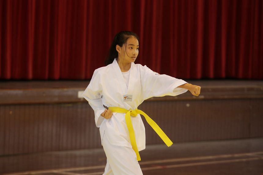 Yap Yu Jun from Tampines Meridian Junior College competing in the individual event at the A Division Taekwondo (Poomsae) Championship, on May 5, 2021.