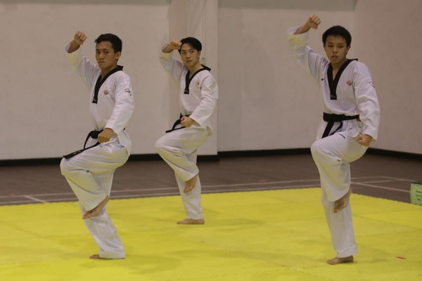 (From left) Donald Oh, Benjamin Koh, and Teh Wei Feng from Anderson Serangoon Junior College competing in the team event at the A Division Taekwondo (Poomsae) Championship, on May 5, 2021.