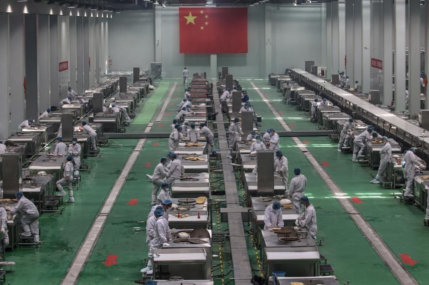 Workers in a food production base during a government organised trip for foreign journalists in Urumqi, Xinjiang, on April 23, 2021.