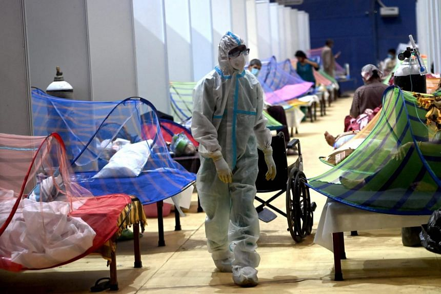 A health worker walks inside the Common Wealth Games stadium temporarily converted into a Covid-19 care centre in New Delhi, on May 5, 2021.