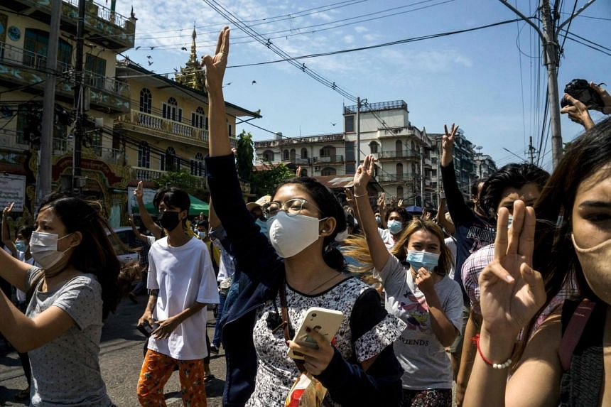 Protesters make the three-finger salute during a demonstration against the military coup in Yangon, Myanmar, on May 7, 2021.