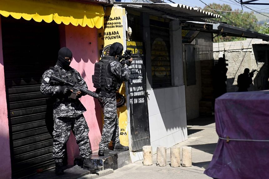 Officers from Rio's Civil Police are seen during a police operation against drug traffickers in the Jacarezinho favela on May 6, 2021.