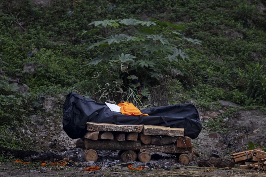 The body of a victim of Covid-19 lying on a funeral pyre on the bank of the Bagmati River in Kathmandu, Nepal, on May 7, 2021.