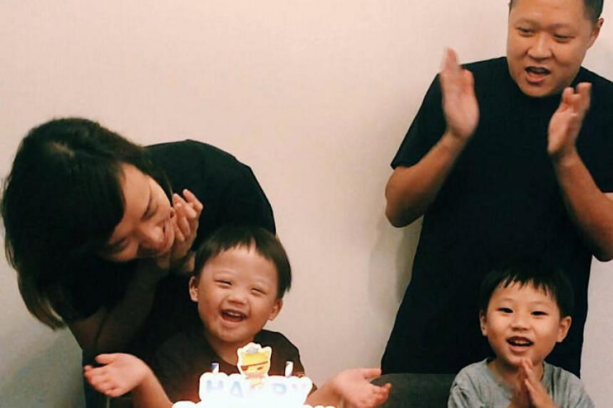 The writer with her son Daniel, seen here celebrating his third birthday. With them are his father Jason, and older brother David.