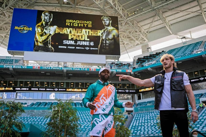 Floyd Mayweather (left) and Logan Paul attend a press conference at Hard Rock Stadium in Florida, on May 6, 2021.
