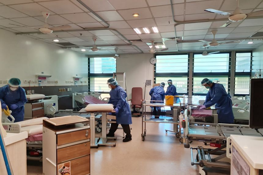 Staff thoroughly disinfecting one of the wards at Tan Tock Seng Hospital.