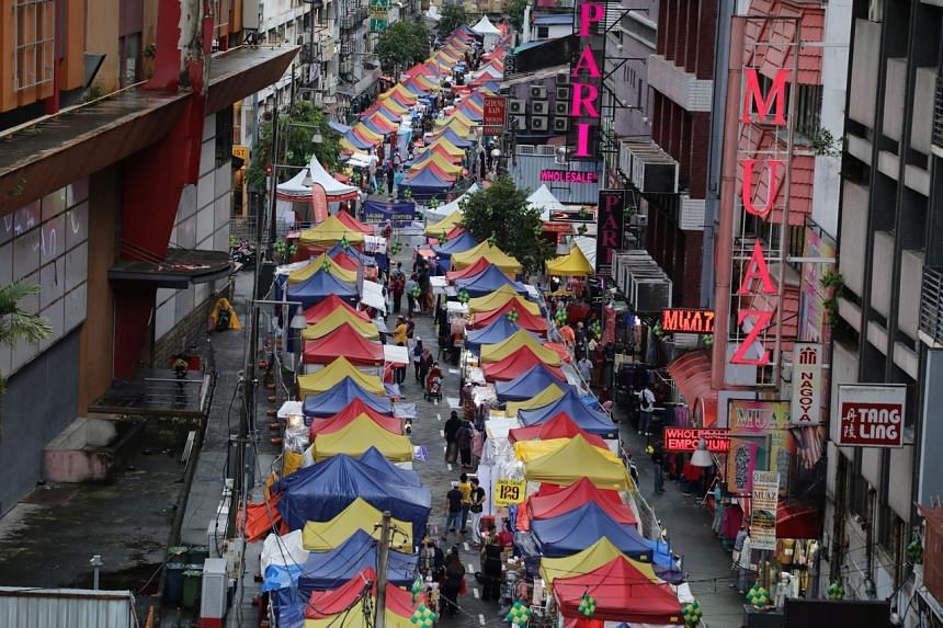 A Ramadan bazaar in Kuala Lumpur on Tuesday amid the pandemic. Such bazaars will not operate for about two weeks after the Malaysian capital was placed under the country's movement control order on May 7, 2021.
