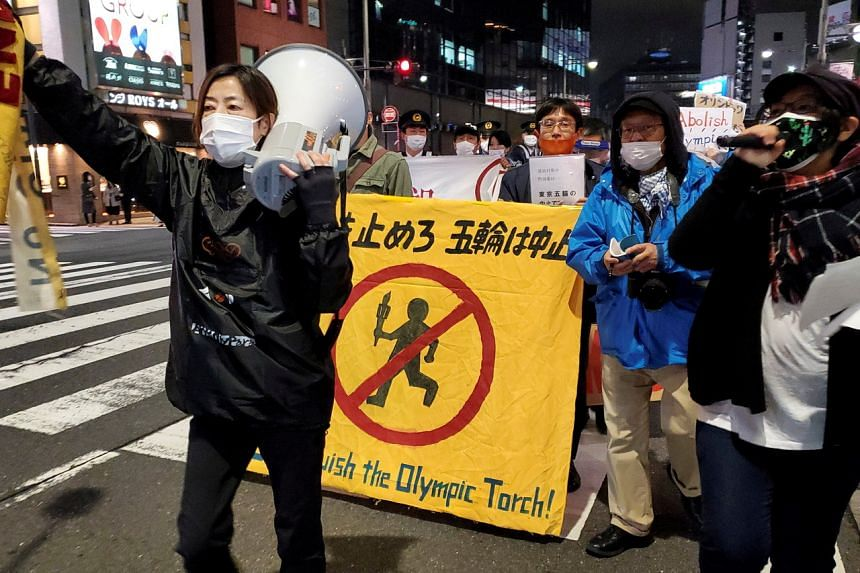Anti-Olympics protesters march in Tokyo, on March 25, 2021.