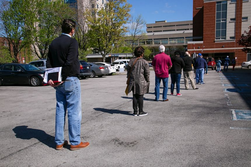 People waiting in a line outside a newly reopened career centre for in-person appointments in Louisville, Kentucky, on April 15, 2021.