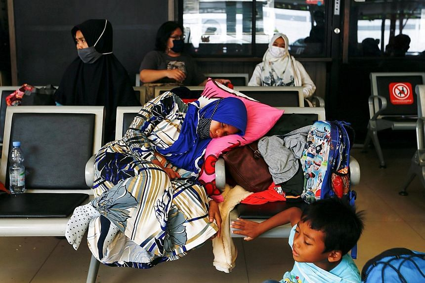 Passengers waiting at a Jakarta train station on Wednesday to return to their home towns for Hari Raya Aidilfitri, ahead of a government ban on this annual exodus from Thursday until May 17. A Ministry of Transport survey showed that 18 million plann