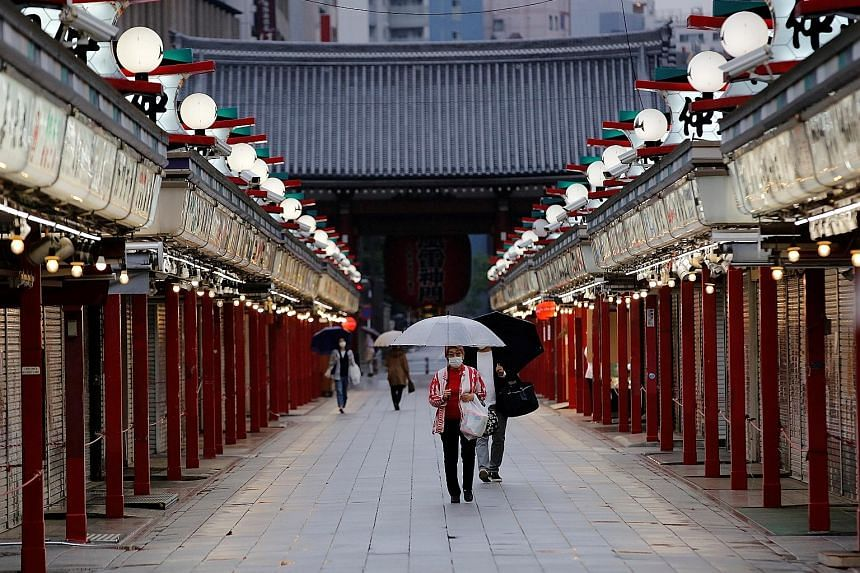 JAPAN Closed shops in the traditional Tokyo district of Asakusa amid the pandemic. Prime Minister Yoshihide Suga yesterday extended Japan's ongoing third state of emergency to May 31 from the intended expiry date of May 11.