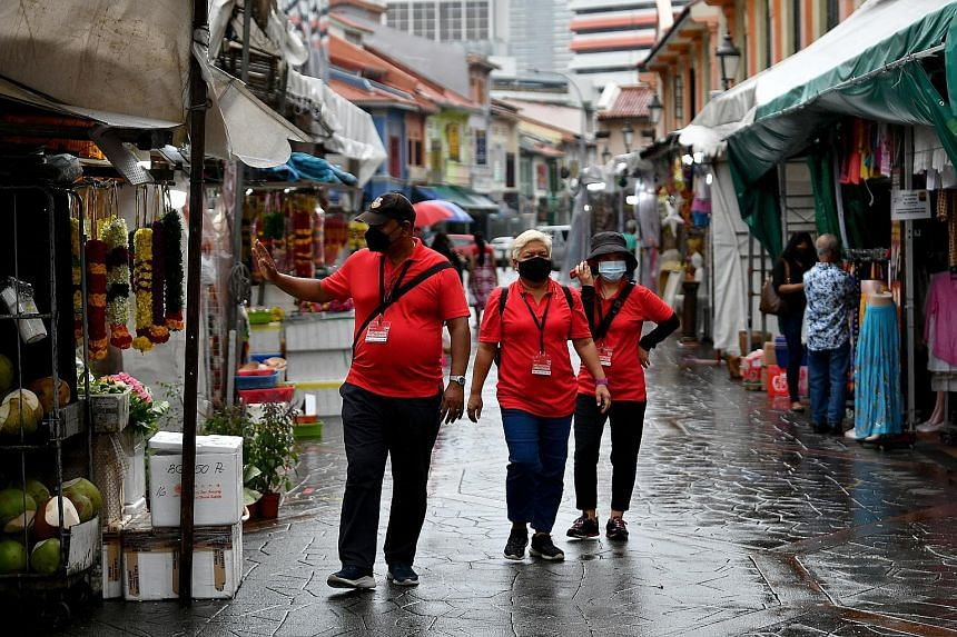 Safe distancing ambassadors in Little India in January. Singapore has reintroduced some measures as a new wave of Covid-19 infections spreads through the community.