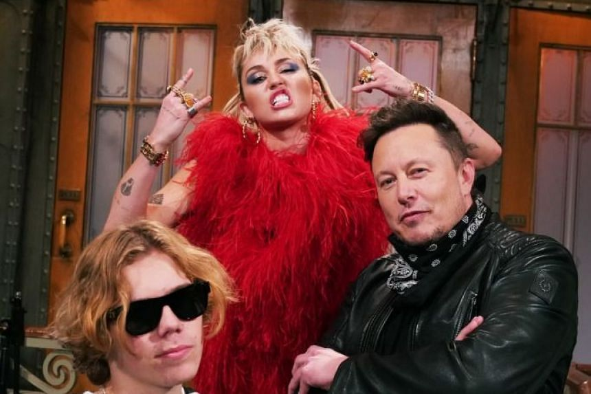 Elon Musk (right) and Miley Cyrus (centre) in a promotional photo sent out on Twitter by SNL.