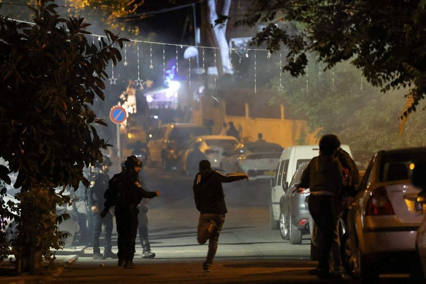 Palestinian protesters clash with Israeli police in Sheikh Jarrah in east Jerusalem, on May 7, 2021.