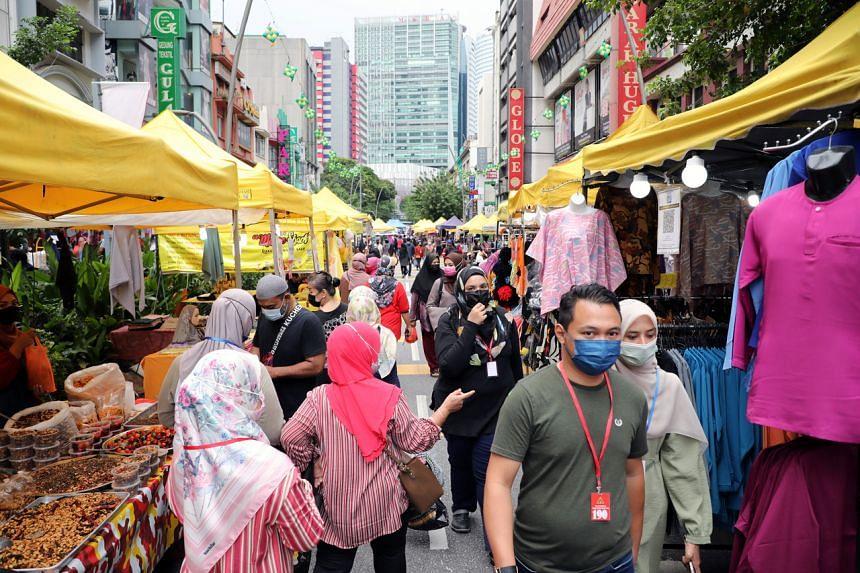 People shop at a Ramadan bazaar during a lockdown in Kuala Lumpur, Malaysia, on May 8, 2021.