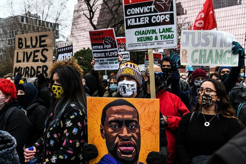 People protest outside of the courthouse during the trial of former Minneapolis police officer charged with murdering George Floyd, on April 19, 2021.