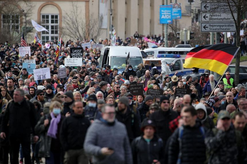 In a photo taken on March 20, 2021, protestors take part in a march demanding the compliance of basic rights in Kassel, central Germany.