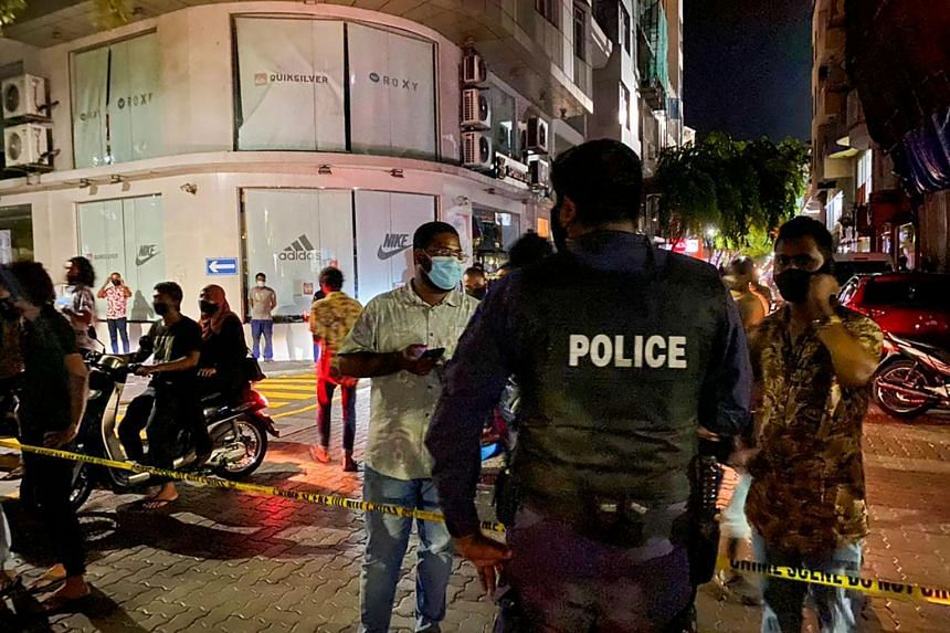 Police secure a site after a suspected bomb blast injured former Maldives president Mohamed Nasheed in Male on May 6, 2021.