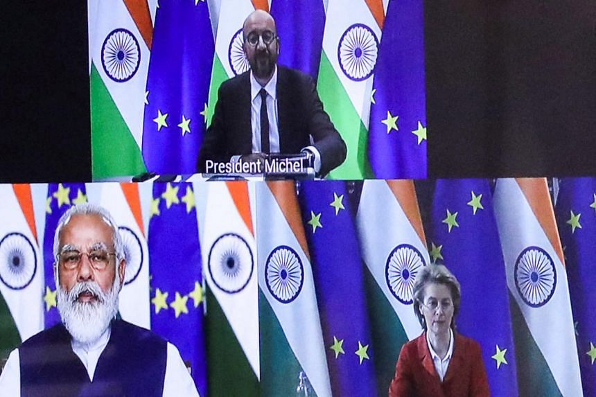 In a file photo taken on July 15, 2020, European Council President Charles Michel (top) takes part in a virtual summit with European Commission President Ursula von der Leyen (right) and Indian PM Narendra Modi.