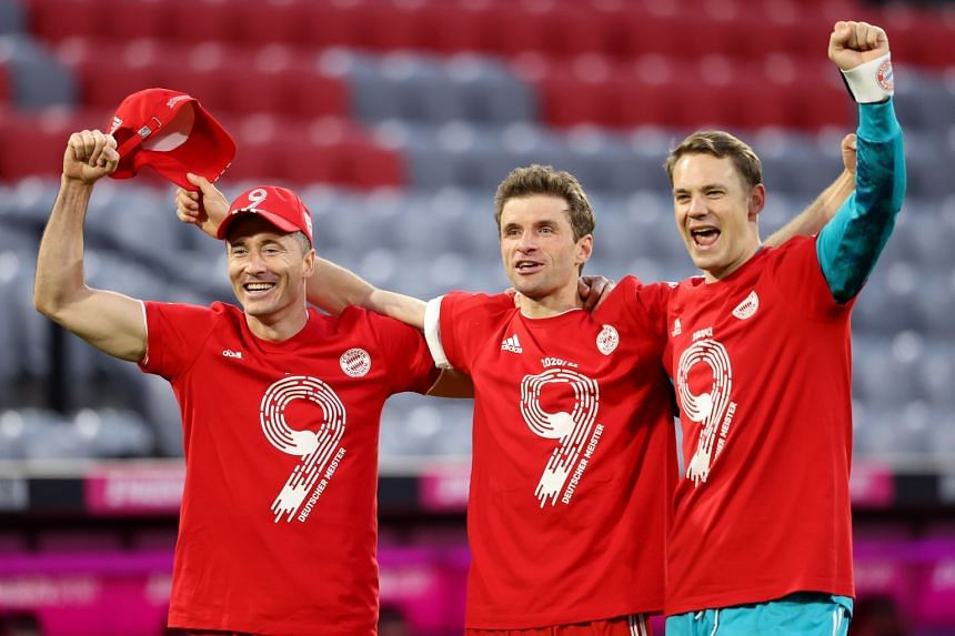 (From left) Robert Lewandowski, Thomas Mueller and Manuel Neuer celebrates winning the Bundesliga title, after beating Borussia Moenchengladbach.