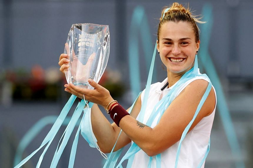 Aryna Sabalenka of Belarus celebrates with her trophy after defeating Ashleigh Barty of Australia.
