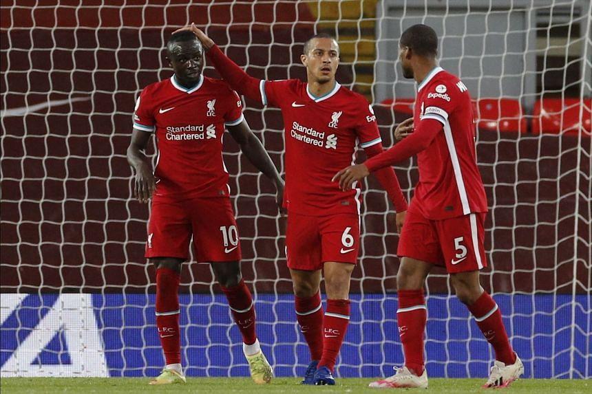 Liverpool's Sadio Mane (left), assisted by Thiago Alcantara (centre) and Georginio Wijnaldum (right), reacts after scoring.