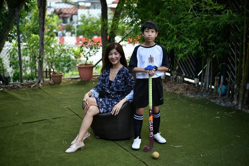 Administrative executive June Low with her 13-year-old son Syamille Iman Jamalluddin, who got into Raffles Institution through DSA hockey.