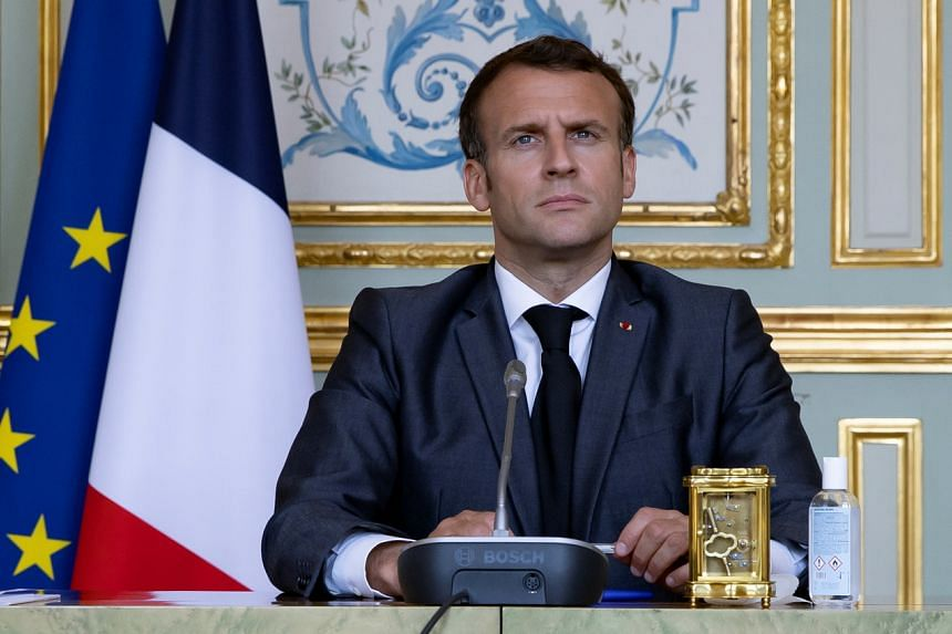 French President Emmanuel Macron attends a Climate Summit video conference at the Elysee Palace in Paris, on April 22, 2021.